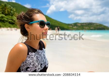 Pretty girl enjoying a beautiful Carrbbean beach in Saint John in the United States Virgin Islands.