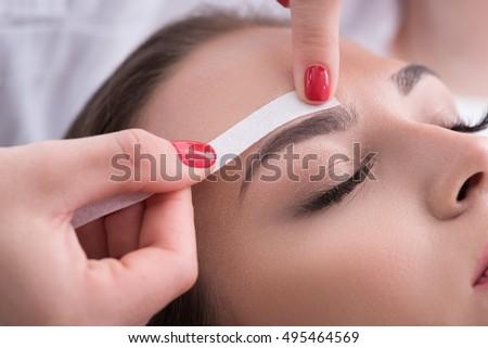 Pretty girl getting brow depilation Сток-фото ©