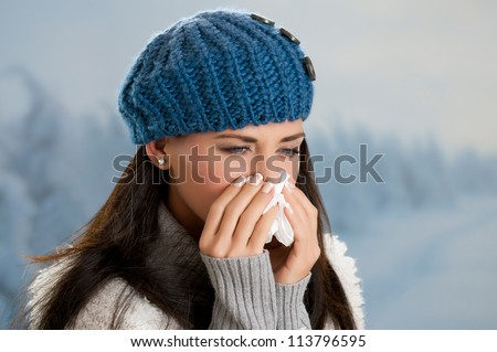 Pretty girl has flu and fever in winter day outdoor