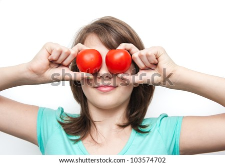 Pretty girl having fun , making glasses with hands and tomatoes
