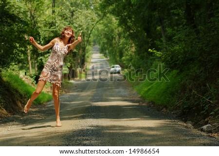 Pretty girl hitching hiking.