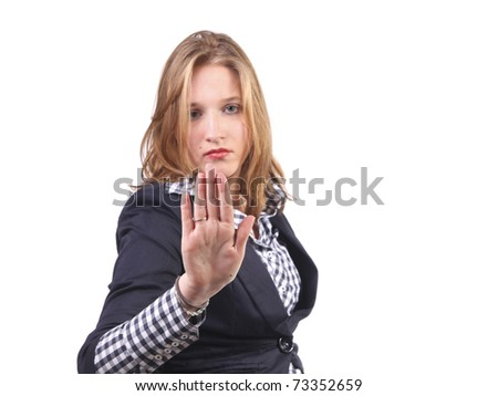 Pretty girl holding up hand and gesturing no and stop. Focus on hand