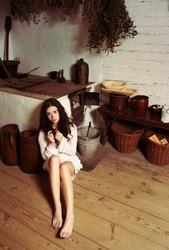 Pretty girl in an old cottage