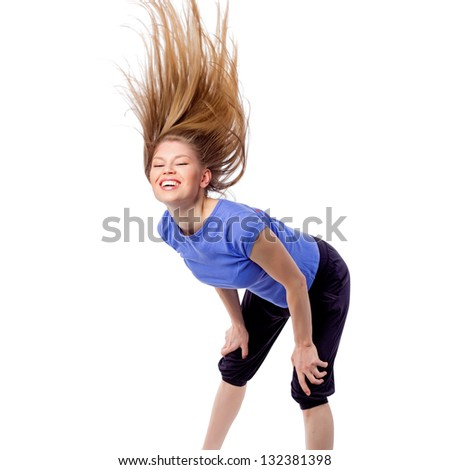 Pretty girl in dancing pose with disheveled hair. Female fitness/ aerobics trainer during dance class. Isolated on white background
