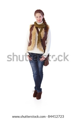 Pretty girl in jeans and pullover smiling.?