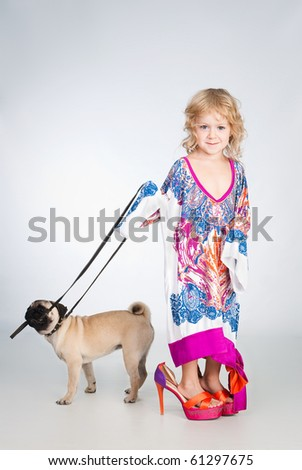 pretty girl in mamas dress hold the dog