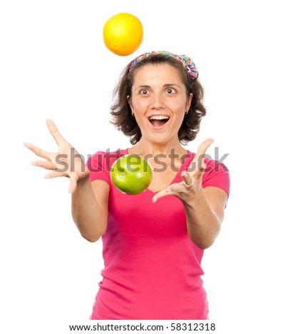 Pretty girl juggling oranges and apples