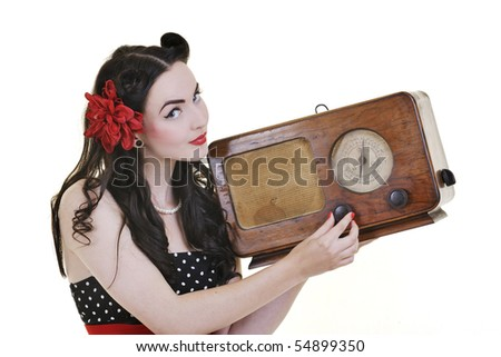 pretty girl listening music on radio isolated on white in studio