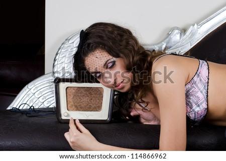 pretty girl listening music on retro radio