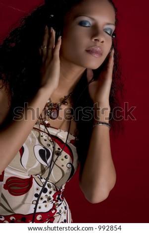 pretty girl listening to music in her headphones