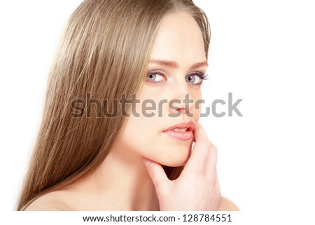 Pretty girl looking to side with thoughtful expression