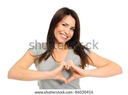 Pretty girl making a heart symbol with her hands over her heart