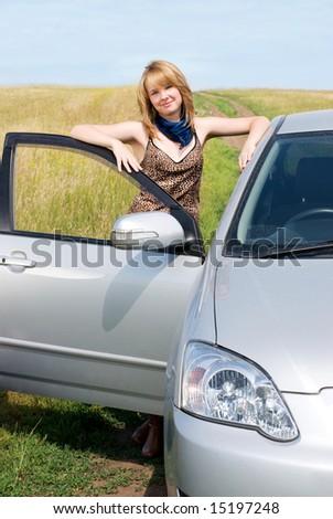 pretty girl near the car