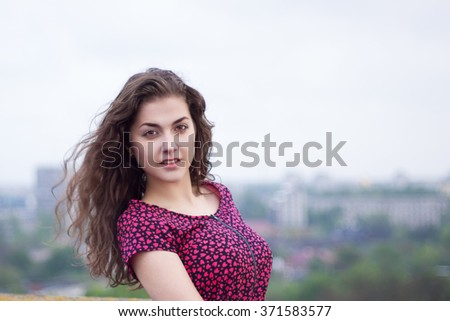 Pretty girl on sky background