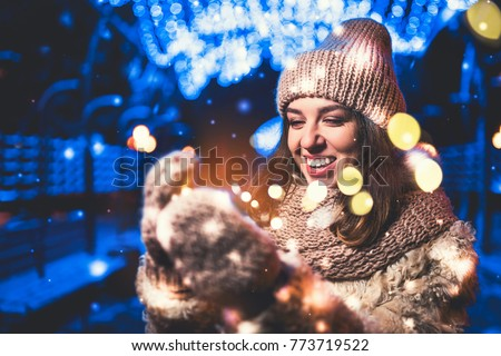 Pretty girl on the street with christmas lights #773719522