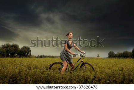 pretty girl riding bike in the countryside