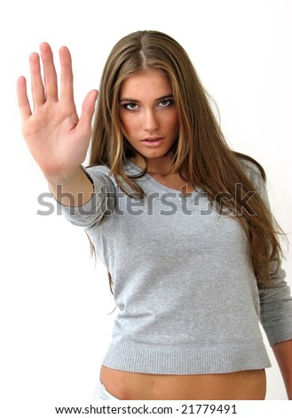 "Pretty girl showing ""Stop!"" gesture with her hand."