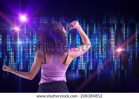 Pretty girl singing against digitally generated cool pixel background
