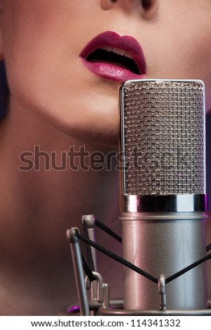 Pretty girl singing with microphone