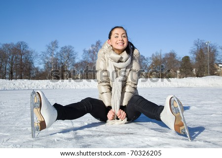 Pretty girl sitting on ice