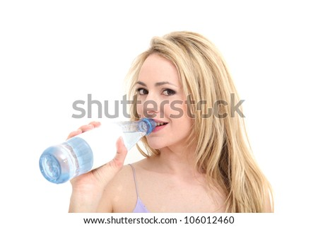 Pretty girl smiles coyly as she drinks water from a bottle for brief refreshment