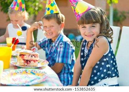 Pretty girl smiling at child's birthday party  #153852635