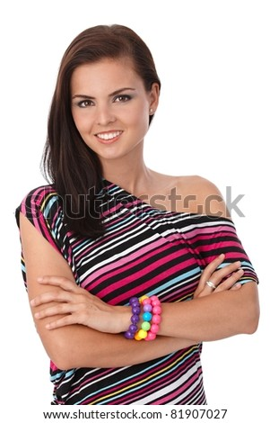Pretty girl smiling in stripy blouse, looking at camera.?