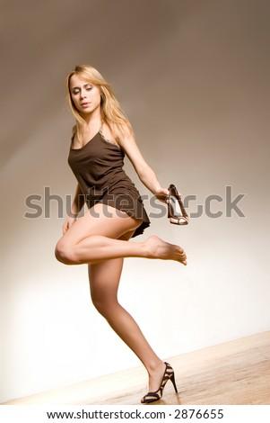 Pretty girl standing on one leg