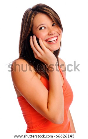 Pretty girl using cell phone smiles and looks over her shoulder out of frame