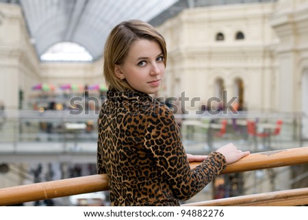 Pretty girl walking in a shop