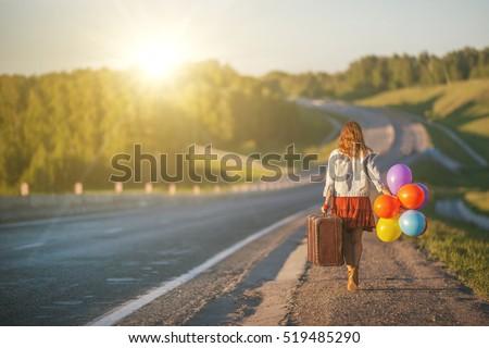 pretty girl walking with big...