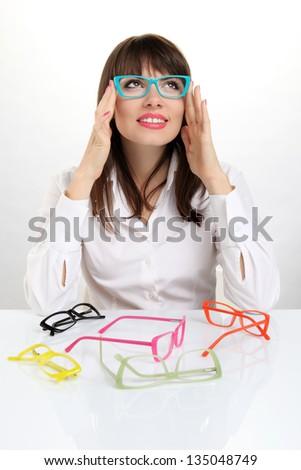 pretty girl wearing colored glasses - stock photo