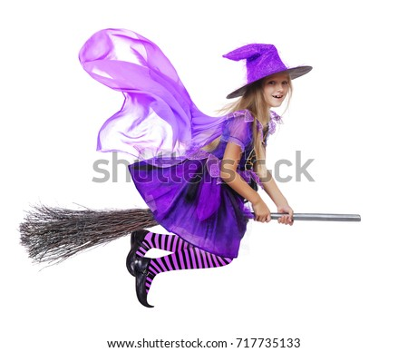 Pretty girl wearing witch halloween dress flying on a broom #717735133