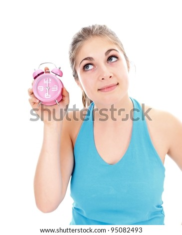 Pretty girl with an alarm clock in her hand, concept