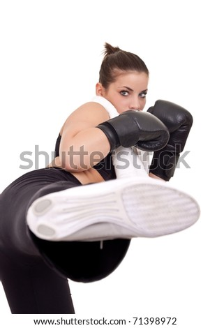 pretty girl with boxing use gloves giving a kick