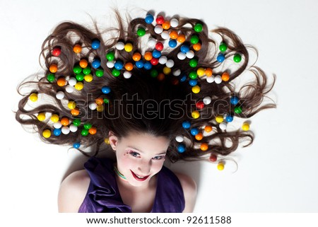 Pretty Girl with Candy Makeup and colorful Gumballs in her hair for Artistic Fun
