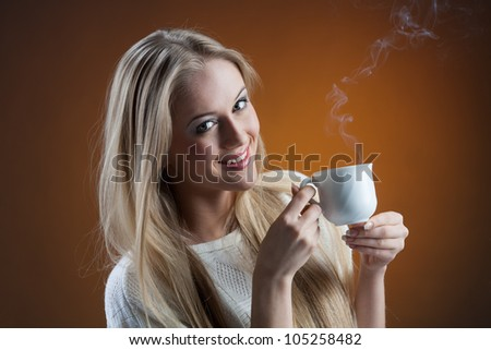 pretty girl with coffee looking at the camera