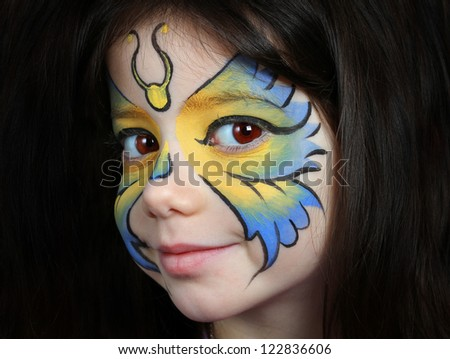 Pretty girl with face painting of a butterfly
