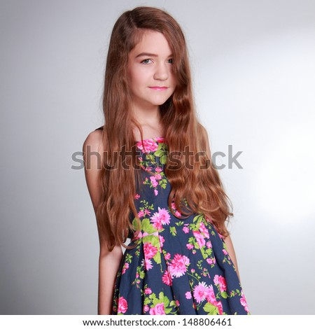 Pretty girl with long brown hair and clean skin on Health and Wellness theme/Cute young woman on Beauty and Fashion theme