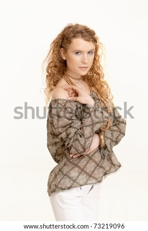 Pretty girl with long curly hair looking at camera shoulders uncovered.?