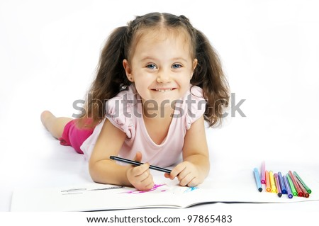 pretty girl with long hair draws markers