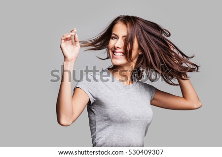 Pretty girl with long hair laughing, dancing and enjoying life