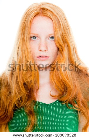 Pretty girl with long red hair wearing green shirt. Natural beauty. Fashion studio shot isolated on white background.