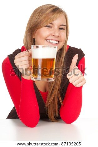 pretty girl with thumb up drinking beer from the mug