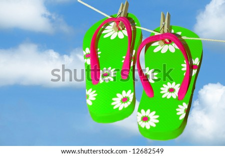 stock photo : Pretty green and pink flip flop sandals on clothes line under pretty sky