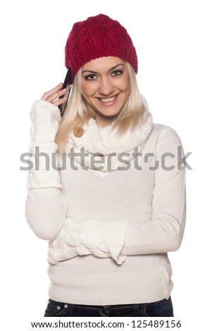 pretty happy blonde girl in red hat on white background telephoning