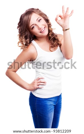 pretty happy young woman showing the sign OK to us, isolated against white background