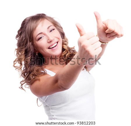 pretty happy young woman with her thumbs up, isolated against white background