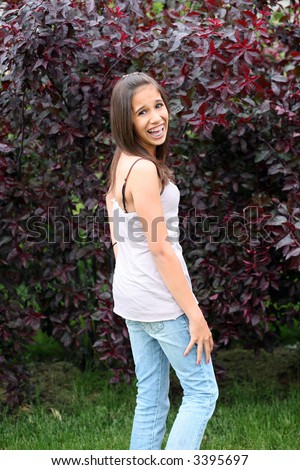 pretty hawaiian preteen with braces laughing