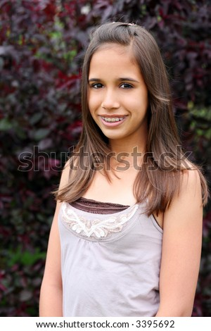 pretty hawaiian preteen with braces smiling